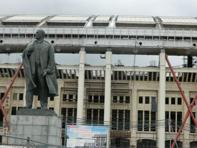 Vladimir Lenin stands proud in front of the historic facade of Luzhniki.